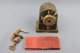 """A mid-20th Century Faber desk-mounting pencil sharpener together with an early 20th Century """""""