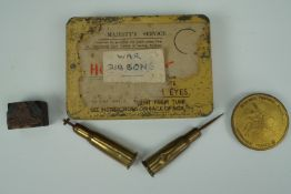 Sundry items including a Second World War anti-gas ointment tin containing military medal ribbons,