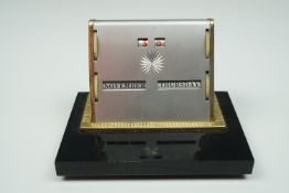 A 1950s perpetual desk calendar, 10.5 cm x 7.5 cm