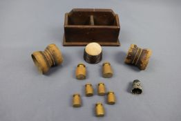 Sundry collectors' items including brass weights, a turned wooden pin cushion, white metal thimble