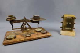 A set of Victorian brass letter scales and sundry weights, together with a desk perpetual