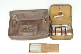 A vintage hide document valise / briefcase, circa 1930s - 1950s, together with a travel grooming set