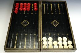 A 19th Century Chinese export gilt black lacquer folding chess and backgammon board, together with