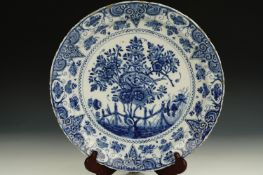 A late 17th / 18th Century large Delft blue-and-white tin-glazed earthenware dish, decorated in
