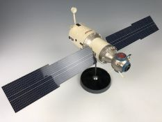 A scale model of a Russian Soyuz spacecraft, plasti-coated alloy, on stand, 59 cm x 27 cm x 27 cm
