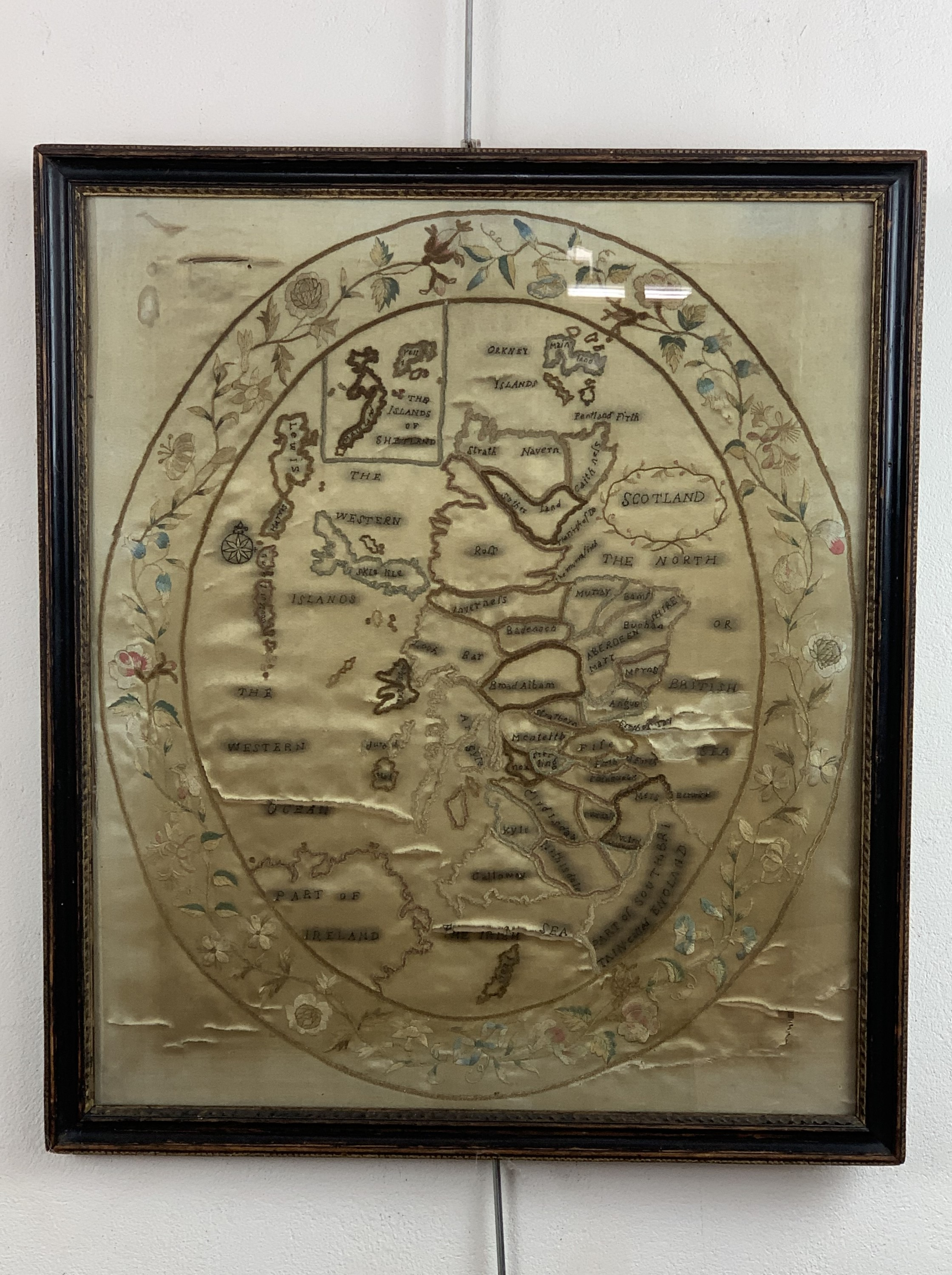 A Georgian Scottish silkwork map of Scotland, the sampler depicting Scotland and the Northern and