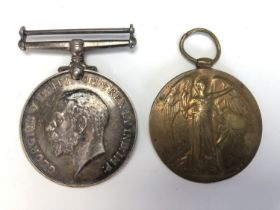 A Victory medal to Rev R J A Johnson, together with a British War Medal, latter erased