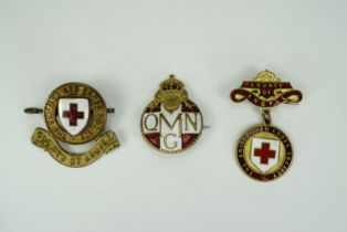 A Great War Queen Mary's Needlework Guild Official's enameled badge, engraved M Burnley Campbell,