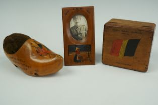 A painted wooden box, pin cushion and picture frame, manufactured by British Royal Naval Division