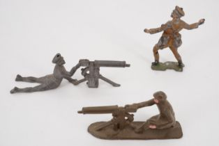 Great War die-cast lead toy machine gunners and a trench bomber