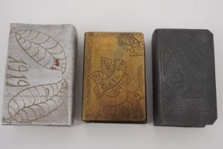 """Three Great War trench art matchbox covers including a brass example engraved """"Coln A/Rh, 1919"""""""