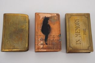 Three Great War trench art matchbox covers including a copper example bearing an enamelled lucky