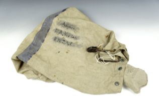 A Royal New Zealand Air Force kit bag with lock and related photograph
