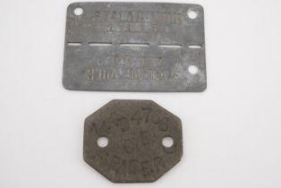 A Second World War German Prisoner of War camp internees identity disc together with a fibre disk
