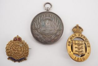 A 1943 West India Football Association Services League winner's medal, together with a 1915