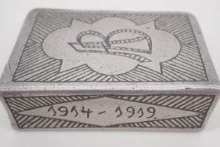 A Great War personalised Prisoner of War trench art matchbox cover and one other