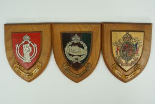Three military plaques: the Royal Tank Regiment, Serve to Lead and the Royal Armoured Corps 17 cm