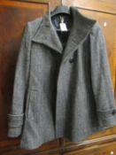 Jaeger ladies black and grey herringbone tweed coat, size 12 (as new with labels) and a Jaeger