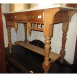 Victorian pitch pine washstand, the tiled back above a marble top, single drawer, turned supports