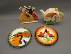 Two boxed Wedgwood Limited Edition plates after Clarice Cliff, together with a Past Times teapot and
