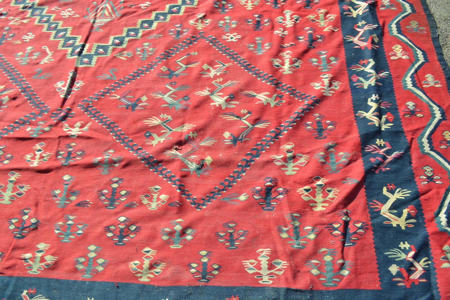 Large Kelim carpet with a five medallion and all-over floral stylised design on a red ground with - Image 4 of 10