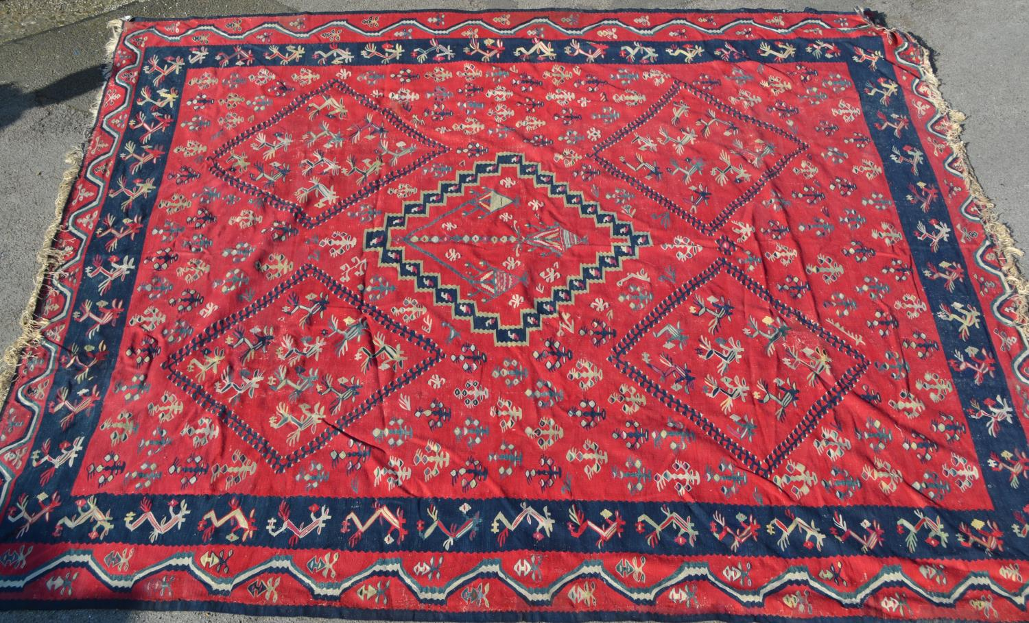 Large Kelim carpet with a five medallion and all-over floral stylised design on a red ground with