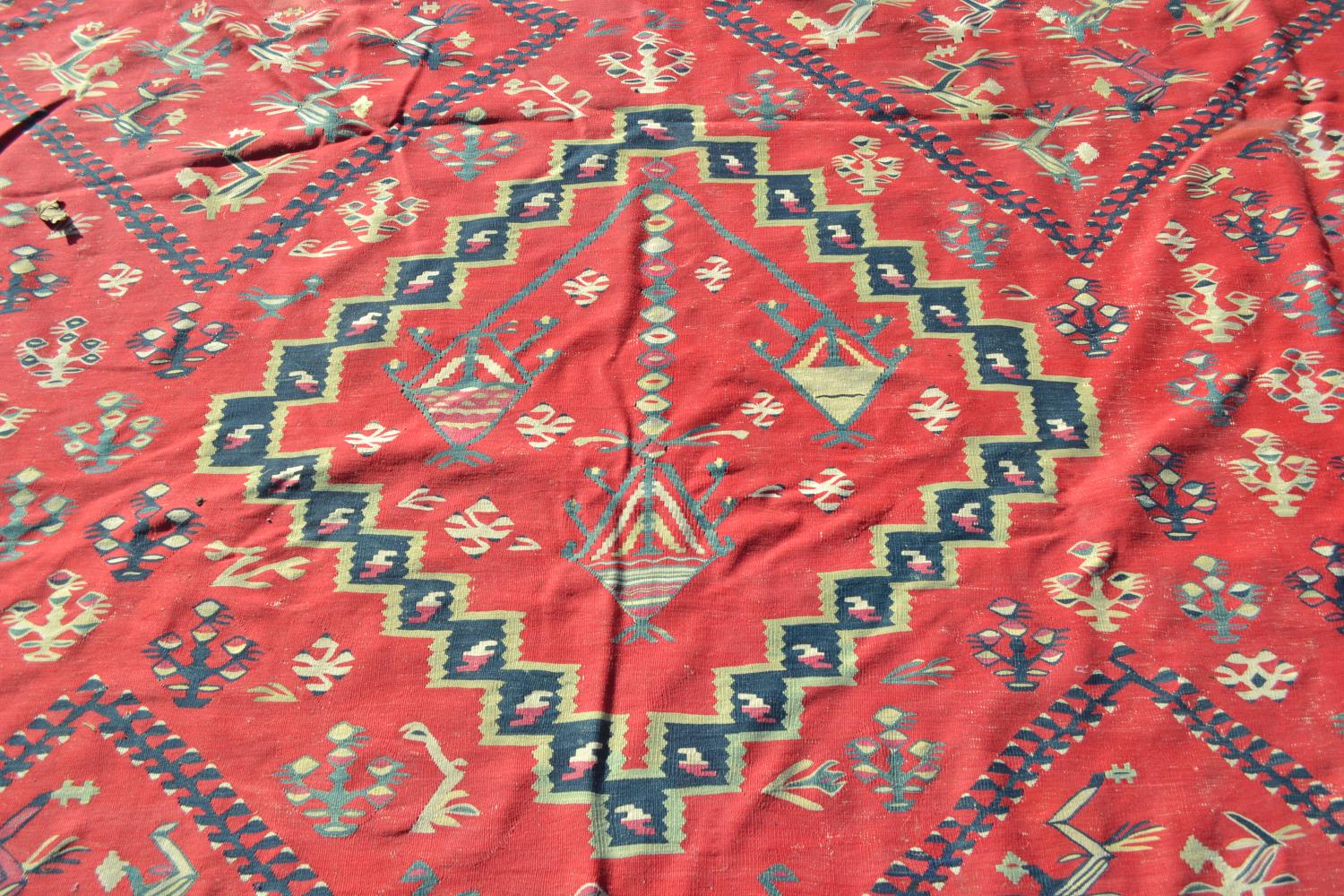 Large Kelim carpet with a five medallion and all-over floral stylised design on a red ground with - Image 3 of 10