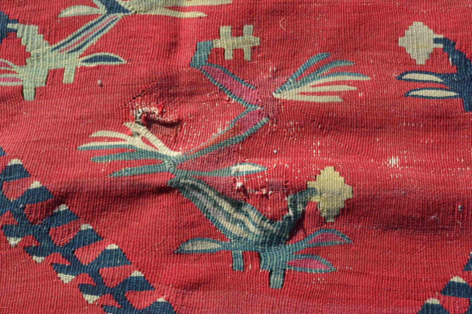 Large Kelim carpet with a five medallion and all-over floral stylised design on a red ground with - Image 9 of 10
