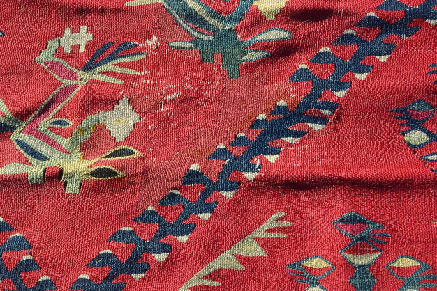 Large Kelim carpet with a five medallion and all-over floral stylised design on a red ground with - Image 10 of 10