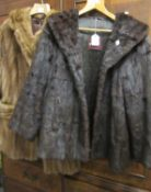 Ladies mid 20th Century half length dark brown mink jacket labelled Karter, together with a