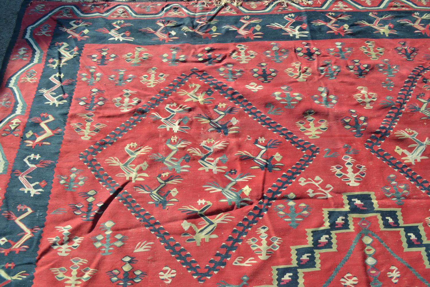 Large Kelim carpet with a five medallion and all-over floral stylised design on a red ground with - Image 2 of 10