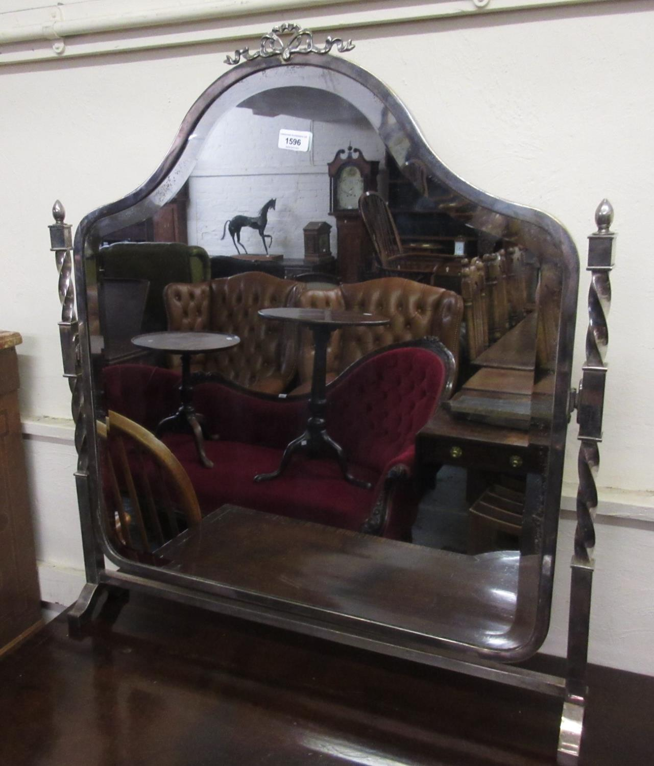 Unusual early 20th Century silver plated swing frame dressing table mirror with a bow surmount,