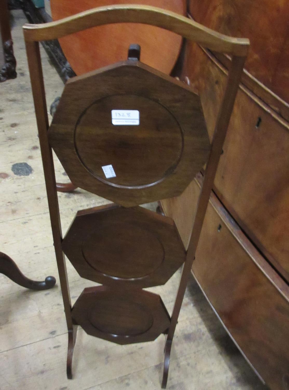 Reproduction circular mahogany games table, a mahogany three tier folding cake stand and a - Image 2 of 3