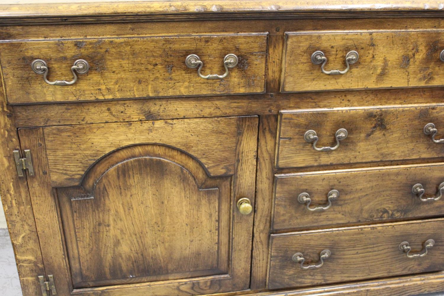 Good quality reproduction oak dresser base, the moulded top above an arrangement of five drawers and - Image 2 of 2