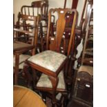 Set of four 20th Century Queen Anne style dining chairs, the splat backs above floral upholstery