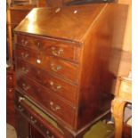 Early 19th Century mahogany bureau, the fall front enclosing a fitted interior above four