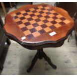 Reproduction circular mahogany games table, a mahogany three tier folding cake stand and a