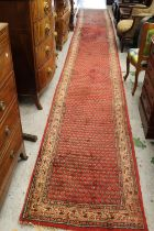 Serabend runner with an all-over Herati design on red ground with borders, approximately 20ft x