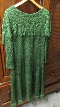 Ladies green dress by Dorville at Michael Geary, London, a Theo sequin and pearl embellished