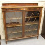 Edwardian mahogany and chequer line inlaid bookcase with a pair of astragal glazed doors enclosing