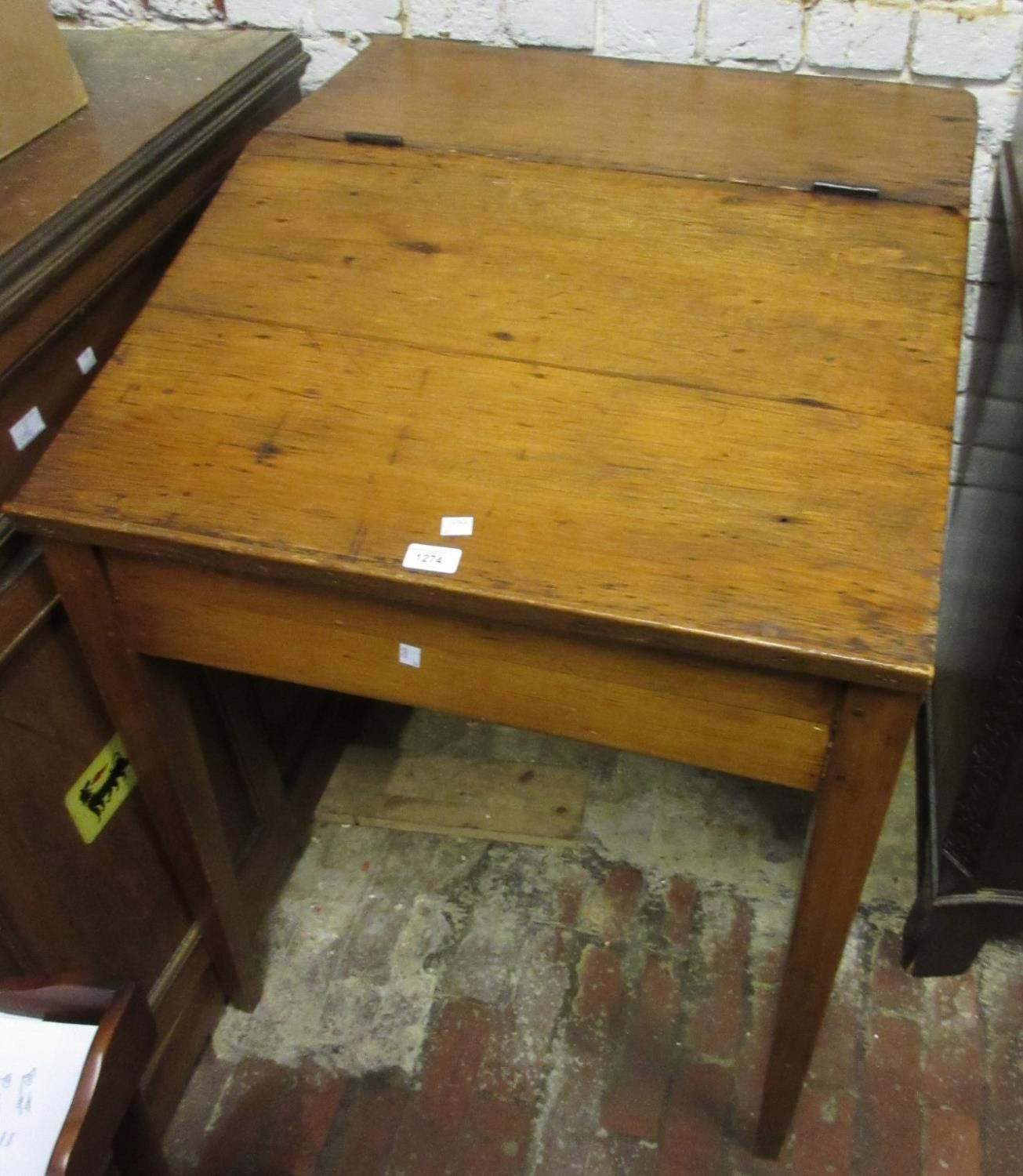 Polished pine clerk's desk with hinged top, raised on square tapering supports, 27ins wide x 31ins