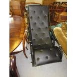Black painted wrought iron rocking chair with black button upholstered seat