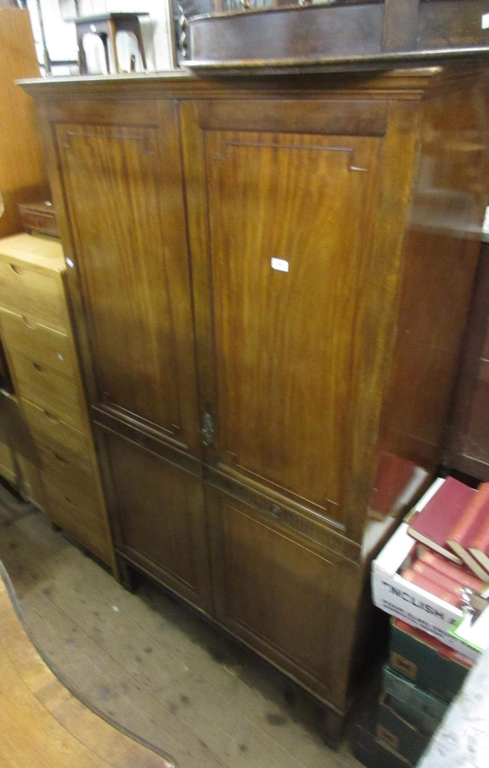 Edwardian mahogany wardrobe, the moulded cornice above a pair of panelled and moulded doors