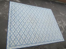 Large modern Chinese machine woven carpet with an all-over blue floral lattice design on an ivory