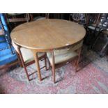 Mcintosh of Kirkaldy mid 20th Century teak circular extending dining table, 48ins diameter, with