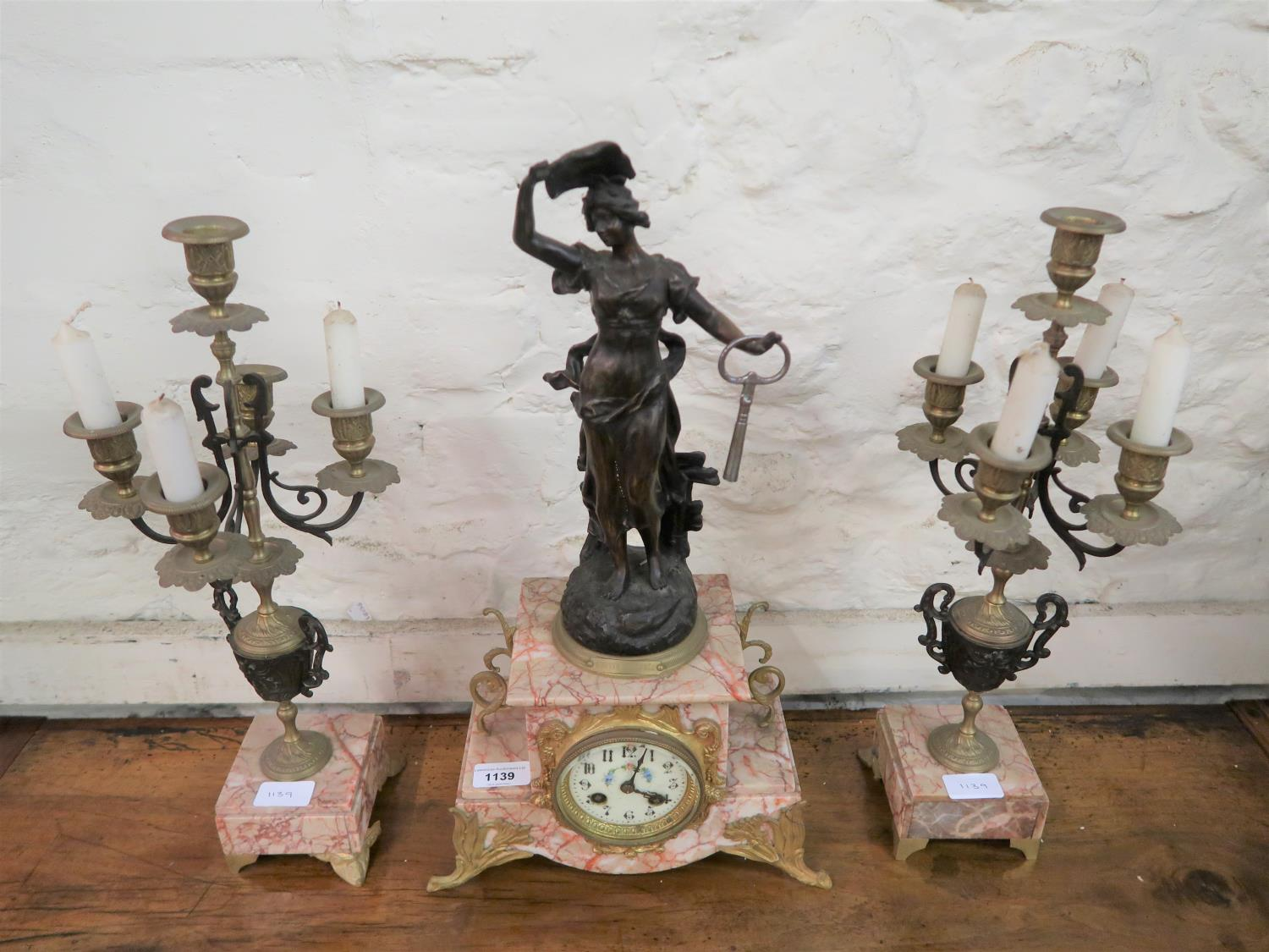 Late 19th Century French dark patinated spelter gilt brass and pink veined marble three piece