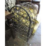 Mid to late 20th Century patinated wrought iron wine bottle cabinet of open work scroll design