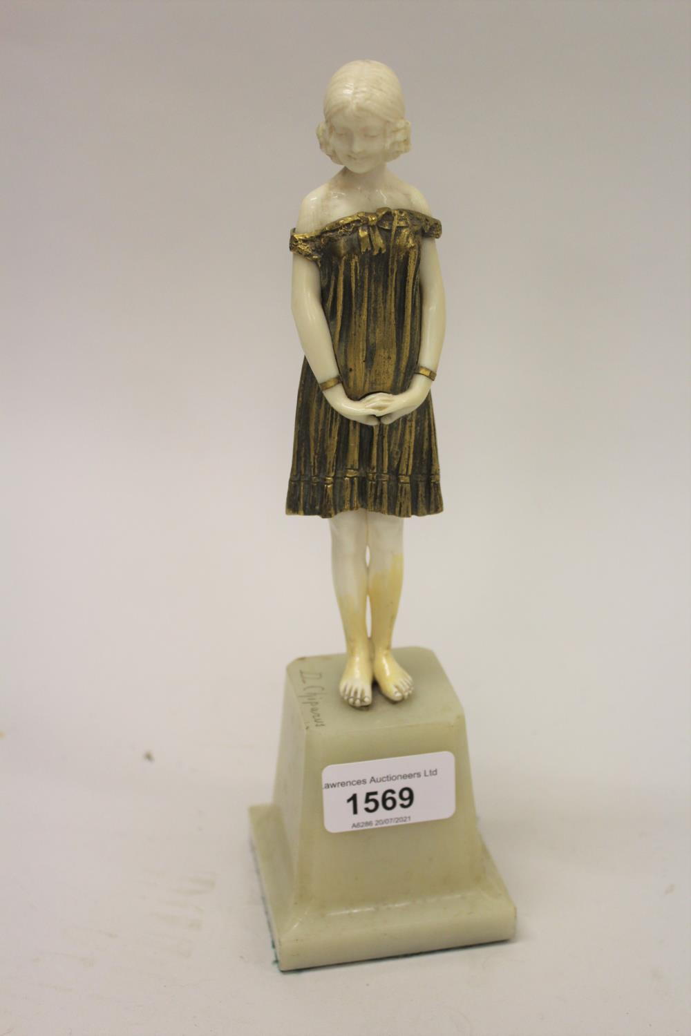 Dimitri Chiparus, small gilt bronze and carved ivory figure of a standing girl on an onyx plinth