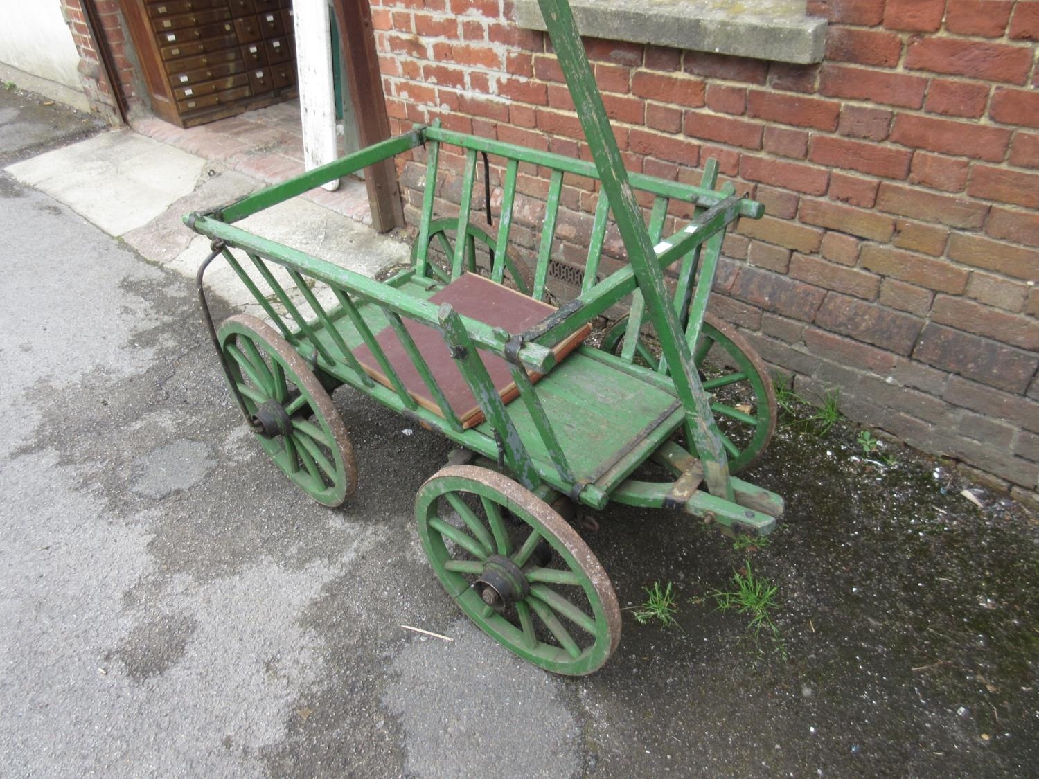 Green painted wooden four wheeled dog cart