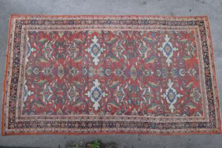 Ziegler Mahal (North West Persian) carpet, the madder filled with bold leafy vines and palmettes,